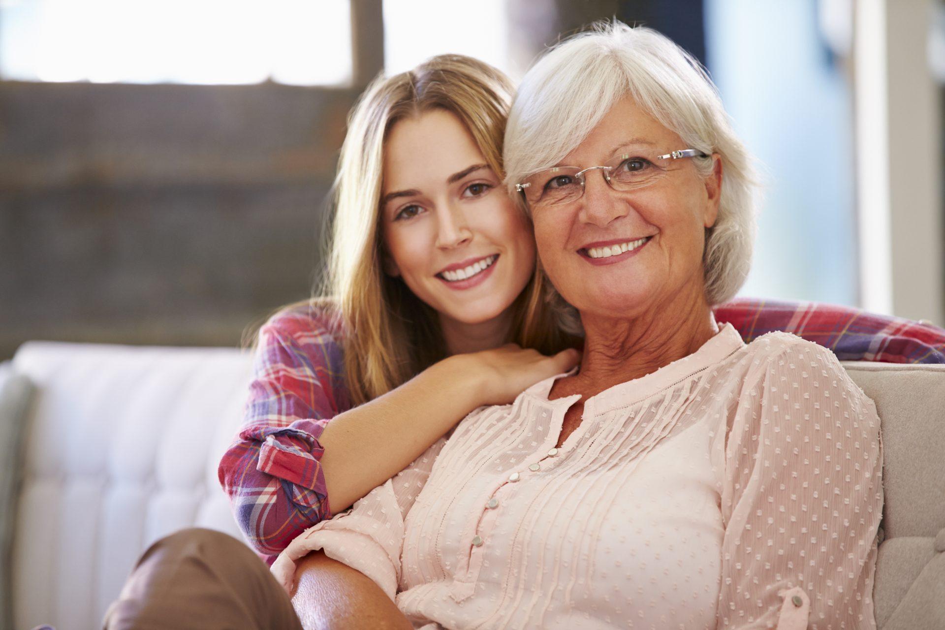Smiling Senior and Granddaughter
